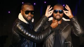 Maitre Gims (L) pulls the beard of his wax look alike at the Musee Grevin wax museum in Paris, France - Monday 2 October 2017