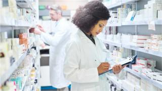 Pharmacists checking medicines