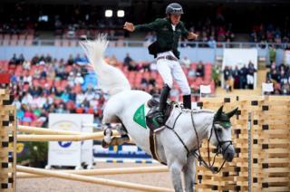 Bertram Allen of Ireland falls from his horse