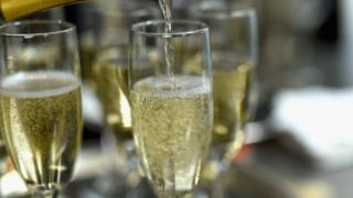 Champagne being poured into Champagne Flutes