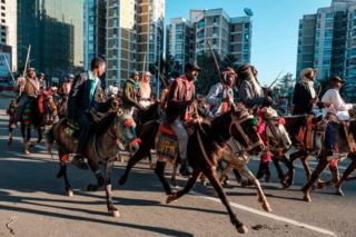 Horsemen trot through Ethiopia's capital Addis Ababa.