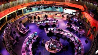 The newsroom at the headquarters of the Qatar-based Al Jazeera English-language channel in Doha, 7 February