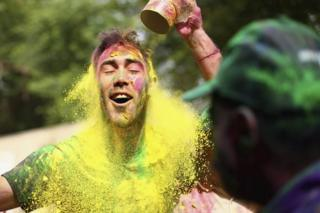 Australian Cricketer Glenn Maxwell celebrates Holi Festival of Colours with Chandigarh locals ahead of the ICC WT20 match between Australia and Pakistan on March 24, 2016 in Chandigarh, India