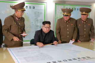 North Korean leader Kim Jong-un visits the Command of the Strategic Force of the Korean People's Army (KPA) in an unknown location in North Korea in this undated photo released by North Korea's Korean Central News Agency (KCNA) on 15 August 2017