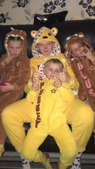 Image of 4 children in Pudsey onesies