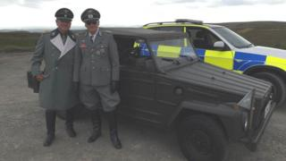 GMP received complaints about this picture of two men in SS uniforms standing next to a Kubelwagen