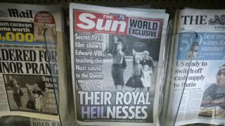 "Front page of the Sun reads ""Their Royal Heilnesses"" and shows picture of Queen as girl doing Hitler salute"