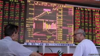 Investors in China watch movements of the stock exchange
