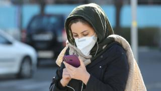 Iranian woman wearing a protective mask in Tehran on 2 March