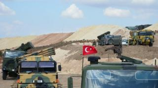 Handout photo made available by Turkish General Staff Press Office shows Turkish military vehicles as they cross into Idlib province, Syria (13 October 2017)