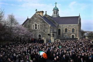 The funeral cortege leaves St Columba's Church and makes it way to Derry City Cemetery on 23 March 2017 in Londonderry-Derry, Northern Ireland.