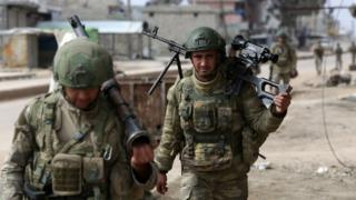 Turkish troops patrol the town of Atareb in Aleppo province, Syria (19 February 2020)