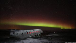 Northern Lights over a plane wreck