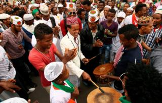 Muslim men sing after attending Eid al-Fitr prayers to mark the end of the holy fasting month of Ramadan in Addis Ababa, Ethiopia July 6