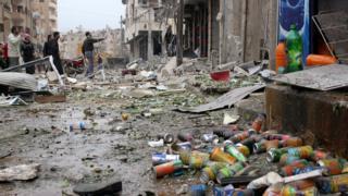 Последствия бомбордировки Ракки силами правительства Башара Асада в 2014 году