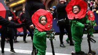 Children in costumes take part in the New Year's Day Parade