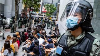 Riot police round up a group of protesters during the demonstration in Hong Kong.