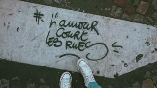"Graffiti tag ""L'amour court les rues"" or ""Love runs the streets"""