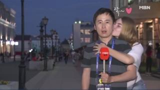 Jeon Gwang-ryeol being kissed by a jubilant Russian fan during live TV broadcast