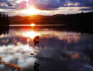 Mike Robinson took this photo during a wild swim at Clunie Loch with son Euan, who is seen here jumping in at sunset.