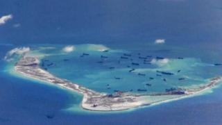 Chinese dredging vessels around Mischief Reef in the disputed Spratly Islands in the South China Sea