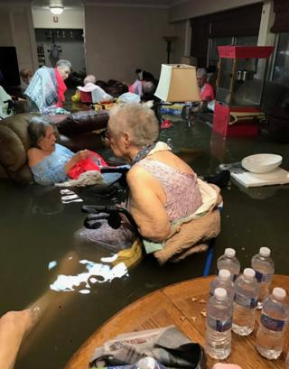 Residents of La Vita Bella assisted living facility are seen in waste-deep flooding due to Tropical Storm Harvey in Dickinson, Texas, 27 August 2017.