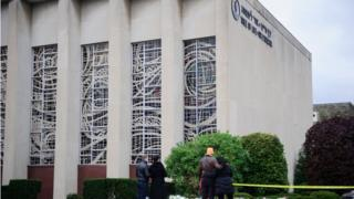Mourners place flowers outside the Tree of Life synagogue