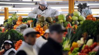 A vendor prepares vegetables in Moscow's Dorogomilovsky Market on February 16, 2011.