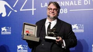 """Guillermo del Toro poses with the Golden Lion for Best Film Award for """"The Shape Of Water"""" at the Award Winners photocall during the 74th Venice Film Festival at Sala Casino on September 9, 2017 in Venice, Italy"""