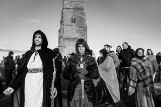 People celebrate a pagan festival dressed in mediaeval clothing