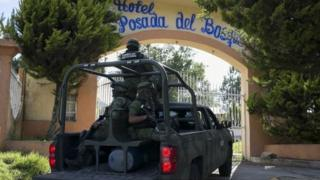 Mexican soldiers guard the funeral of Ocampo municipality Mayor and candidate for the Democratic Revolutionary Party (PRD), Fernando Angeles, in Ocampo, Michoacan State, Mexico, on June 21, 2018.
