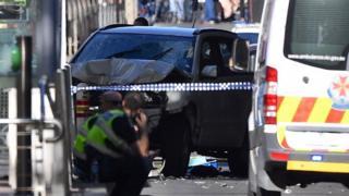 A crashed car that struck pedestrians on Flinders Street, Melbourne, 21 December
