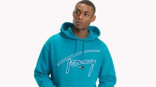 Man in a Tommy Hilfiger hoodie