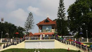 Indian Christian devotees queue to pray at the tomb of Sister Alphonsa in Pala, some 70kms south-east of Kochi on October 11, 2008.