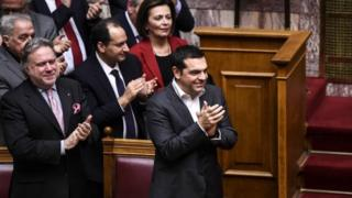 Greece's Prime Minister Alexis Tsipras celebrates after winning vote