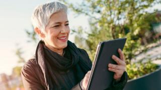 Tech A woman using a tablet computer