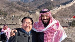 Crown Prince Mohammed bin Salman poses for camera with the Chinese Ambassador to Saudi Arabia Li Huaxin during a visit to Great Wall of China in Beijing, China February 21, 2019.