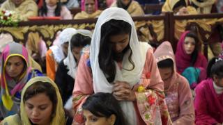 Christian devotees attend Christmas Day prayers at St. Johns Cathedral Church in Peshawar