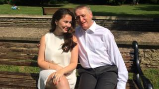 Caitlin and Mike Lambert sitting on a park bench