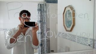 Ben Field in front of mirror message