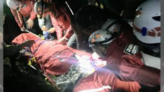 Rescuers attend the injured biker