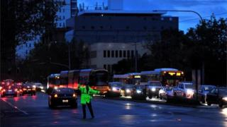 Police direct traffic in the central business district (CBD) of Adelaide after severe storms and thousands of lightning strikes knocked out power to the entire state of South Australia, September 28, 2016.