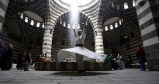 """Dervish dancers performs during an event titled """"the Festival of the Syrian Bread held at Khan Asaad Basha in the old city of Damascus, Syria, on 1 April 2019."""