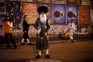 in_pictures Children wear costumes and play during the Jewish holiday of Purim, in Ashdod, Israel. 9 March 2020