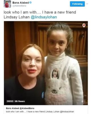 "A tweet from Bana Alabed with a video of her and Lindsay Lohan, saying: ""Look who I am with... I have a new friend"""