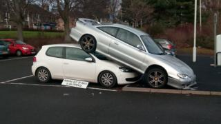 Car parked on top of another one