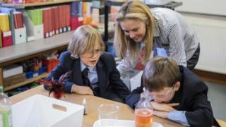 Susanna Naylor helping pupils make lava lamps at Christ Church Cathedral School
