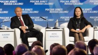 """Russia""""s President Vladimir Putin (L) and Meng Wanzhou, Executive Board Director of the Chinese technology giant Huawei, attend a session of the VTB Capital Investment Forum """"Russia Calling!"""" in Moscow, Russia October 2, 2014"""