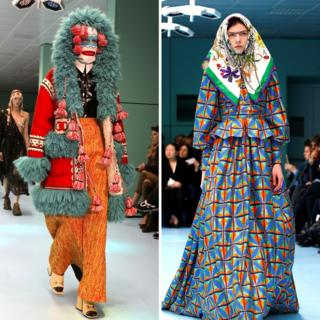 Two models on the catwalk, one wearing an brightly coloured wool skirt, jacket and hat, the other wearing a brightly patterned dress and headscarf