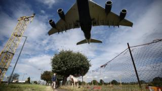 A passenger plane comes into land at Heathrow Airport, west London